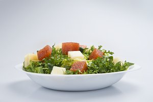 Green salad with cheese and quince