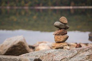 Balancing Stones On A Rock Wall