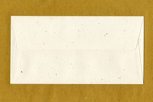 Letter envelope over paper background