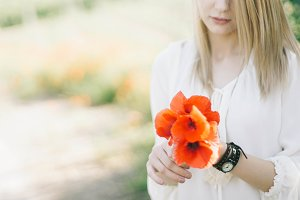 blonde woman portrait with poppies
