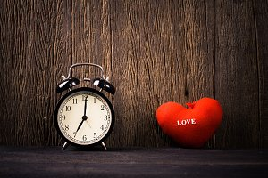 Alarm clock and red heart