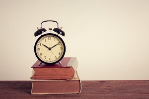 Alarm clock and old book