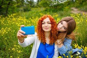 Girlfriends doing selfie