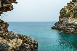 Turquoise sea bay with cliff