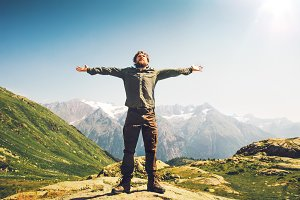 Man traveler hands raised outdoor