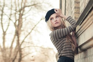 blond girl in a beret and skirt