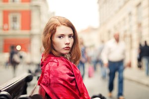 red-haired girl in a red scarf