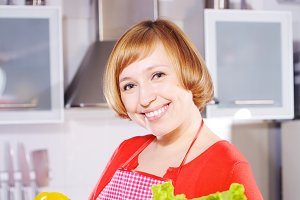 Housewife with fresh vegetables