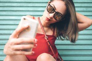 Asian woman taking a selfie