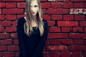Blonde near the red wall