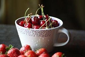 Cherry bowl and strawberries