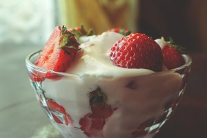 Tasty cream and strawberries