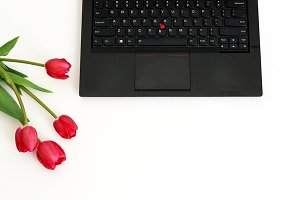 Feminine desk with flowers & laptop