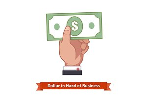 Businessman hand holding dollar bill