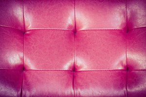 Red leather upholstery background
