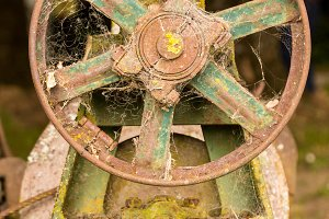 Old farm machinery with fly wheel