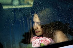 Young girl sitting in a car