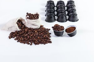 capsules of ground coffee for coffee, roasted coffee beans in a