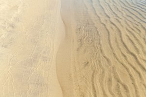 the texture of the sand in the water, river sand, coastline, bea