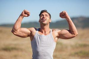 Fit man raising arms