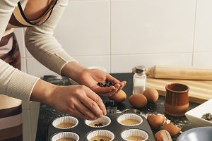Woman Preparing Cookies And Muffins.