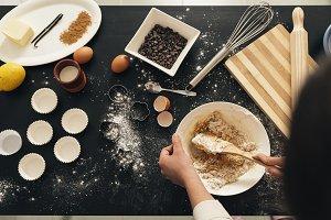 Woman Preparing Cookies And Muffins.