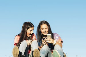 Teenage Girls Using Mobile.