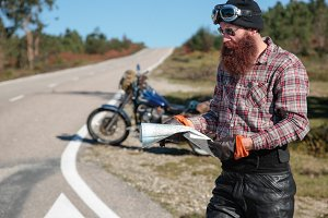 Motorcycle rider holding a map