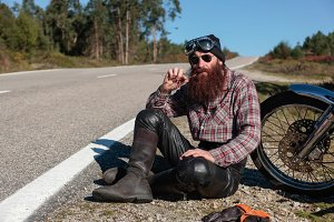 Biker taking a rest on the road