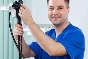male doctor endoscopist is preparing