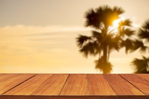 Wood table top on palm tree
