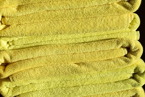 Stack of yellow beach towels
