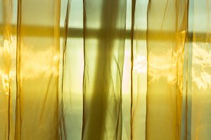 Sunlight through lace curtains