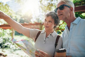 Couple holding a map and pointing