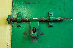 Sliding lock on prison door