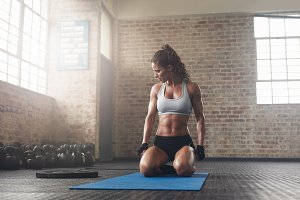 Fitness young woman sitting