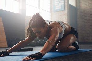 Young woman doing yoga on the gym