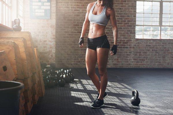 Muscular woman standing