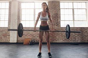 Tough young woman exercising