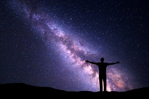 Universe with silhouette of a man
