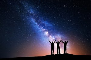 Milky Waye. Silhouette of a family