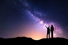 Universe with silhouette of men