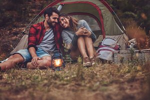Romantic couple on a camping holiday
