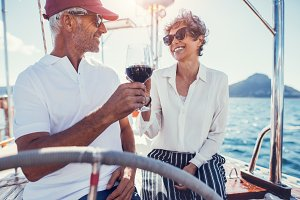 Happy senior couple enjoying wine