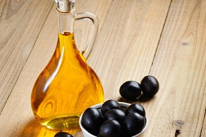 Bottle of olive oil and olives