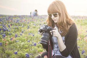 Female Photographer in Flowers