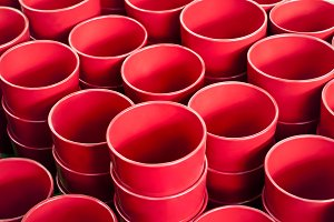 Red flower pots in rows