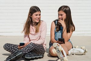 two girls and smartphone happy