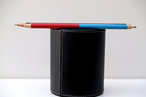 colored pencils on a holder pencil