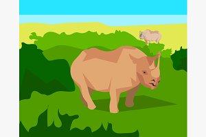 Rhino on background bushes